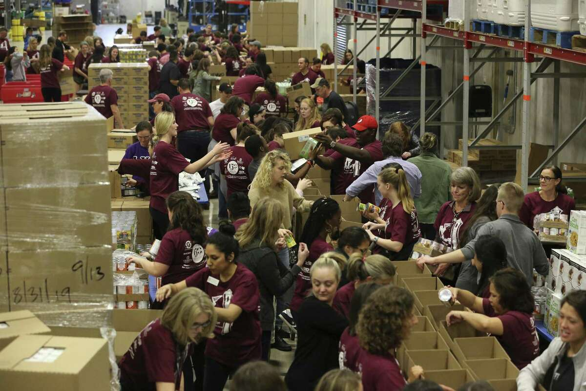 Trinity University kicked off a year-long celebration of its 150th anniversary with an afternoon of city-wide community service projects. Students, alumni and employees went to the San Antonio Food Bank to volunteer their time packing boxes of food for seniors on Friday, Feb. 1, 2019. About 150 people from Trinity turned out about 2,100 boxes of food containing juice, cereal, pasta, canned fruit, canned vegetables, protein, dry milk and peanut butter. The effort can usually take several days but with the turnout on Friday, the Trinity group had that quantity done in about two hours. (Kin Man Hui/San Antonio Express-News)