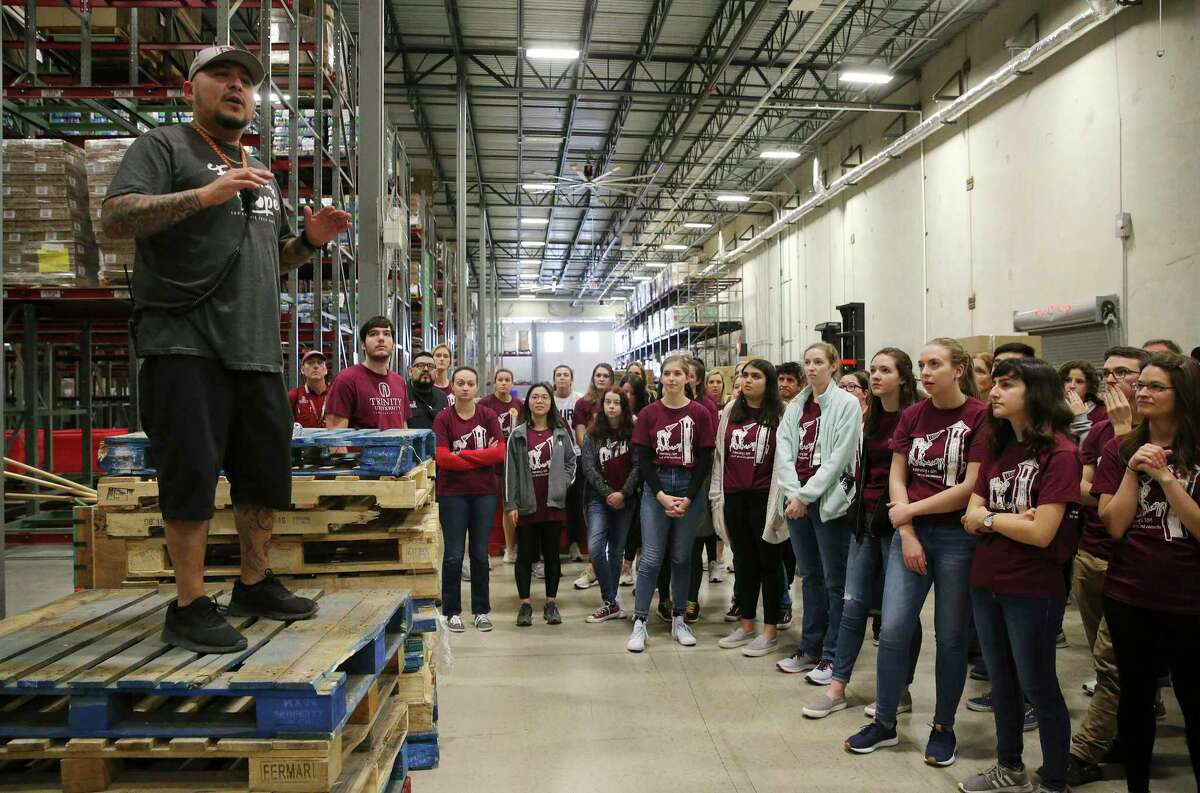 In this 2019 photo, volunteers from Trinity University get prepped at the San Antonio Food Bank. But as demand for food has surged with the pandemic, volunteerism at the food bank has dropped off.