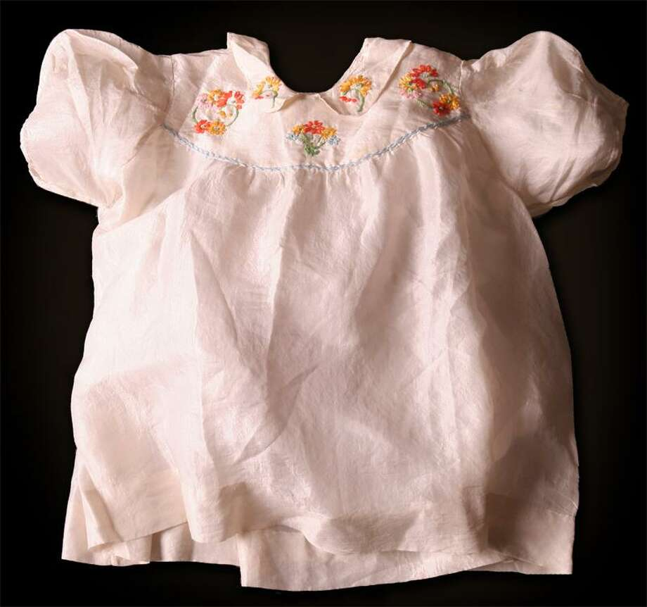 Holocaust survivor Chaja Verveer's baby dress. Photo: Courtesy Of Holocaust Museum Houston
