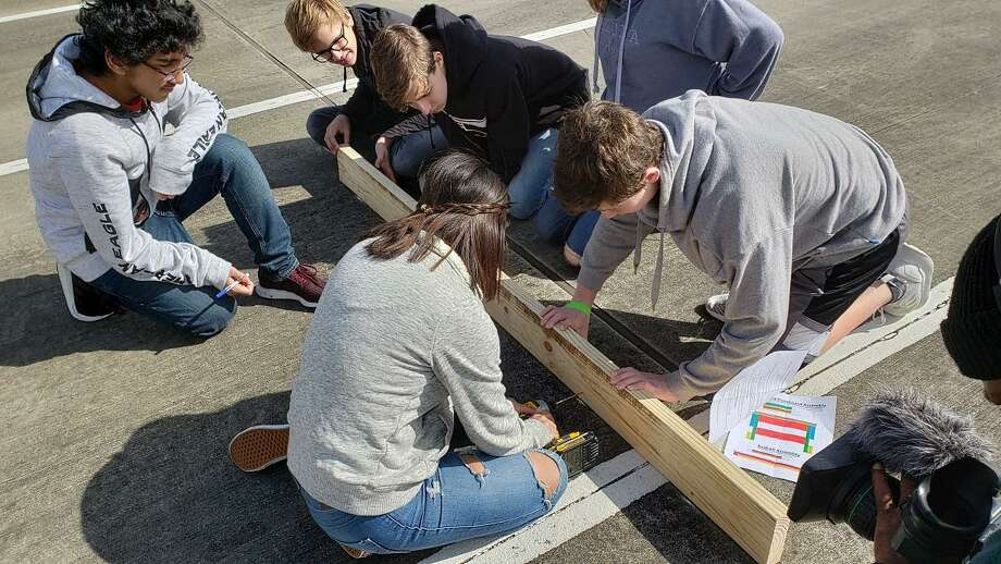 Area youths do basic woodworking and assembling of beds for CPS kids. Photo: Courtesy Photo