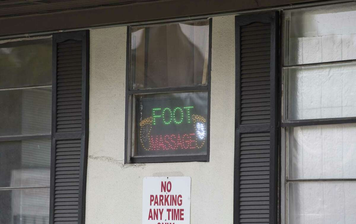 A foot massage sign shows a massage parlor on Richmond Avenue which was sued by Harris County for being the front for prostitution on Friday, Nov. 11, 2016, in Houston.
