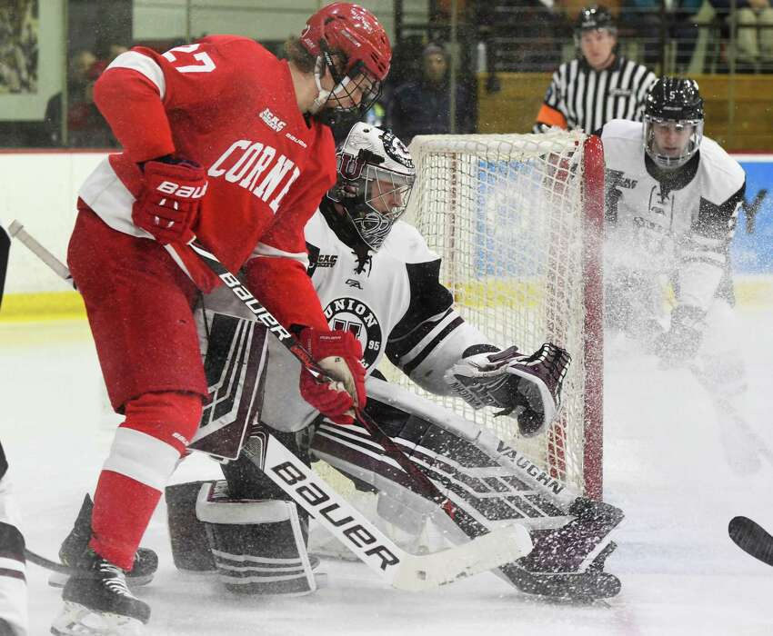 Cornell forward Morgan Barron looks on as the puck goes adrift from the net along with Union goalie Darion Hanson during a game at Union College on Friday, Feb. 1, 2019, in Schenectady, N.Y. (Jenn March, Special to the Times Union)