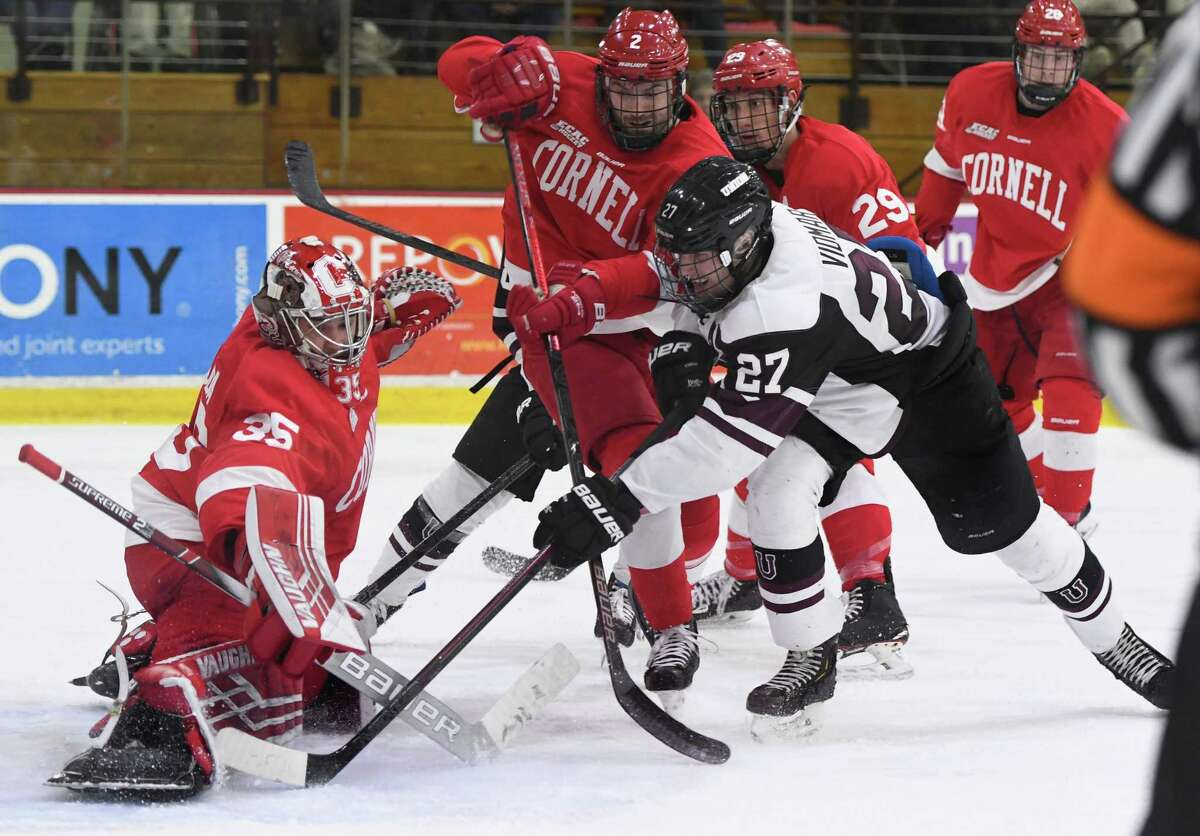 Cornell goalie Matthew Galajda stops a rebound attempt from Union forward Sebastian Vidmar during a game at Union College on Friday, Feb. 1, 2019, in Schenectady, N.Y. (Jenn March, Special to the Times Union)