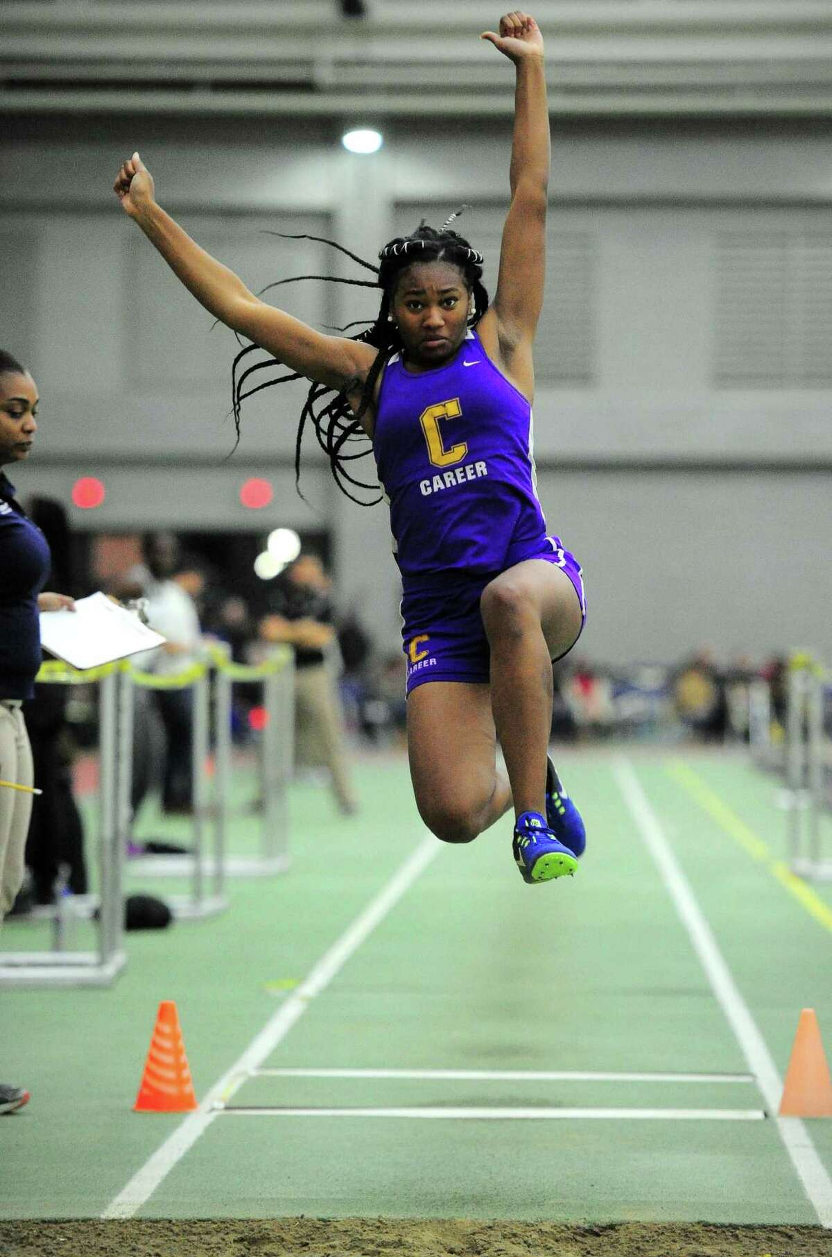 Career's Amaje Freeman competes in the long jump during the SCC Indoor Track and Field Championship Friday in New Haven.