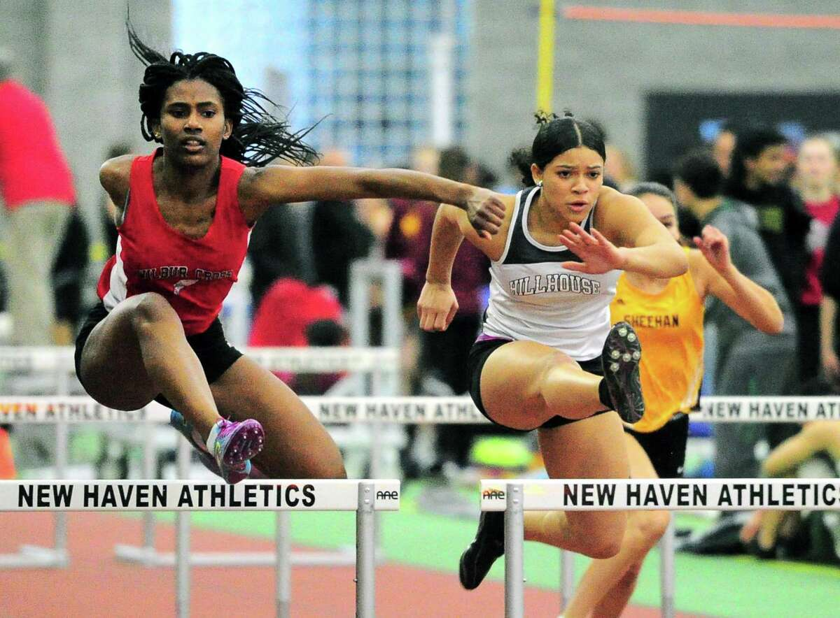 Wilbur Cross' Sadeja Angus, left, and Hillhouse's Vida Harris compete in the 55 meter hurdles during the SCC Indoor Track and Field Championship Friday in New Haven.