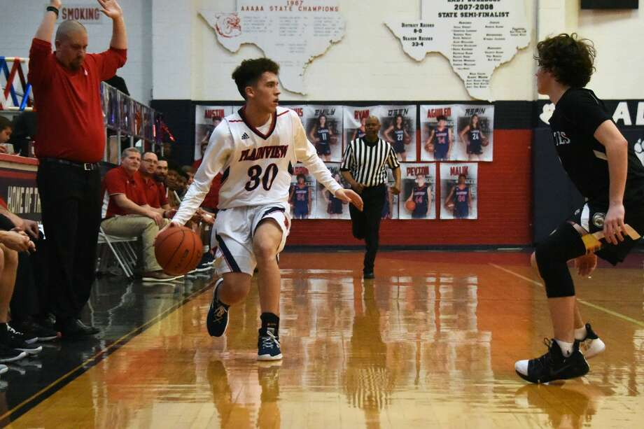 The Lubbock-Cooper Pirates basketball team used a fourth-quarter run to beat the Plainview Bulldogs, 66-56, during District 3-5A play on Friday night in Plainview. Photo: Claudia Lusk/Plainview Herald