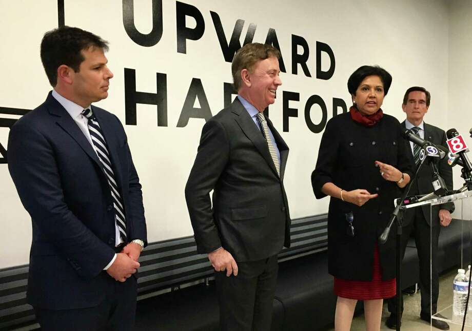 The Connecticut economic development team under Gov. Ned Lamont, introduced in Hartford Friday, Feb. 1, 2019. From left, David Lehman, 41, of Greenwich, leaving his job as a top manager at Goldman Sachs; Lamont; Indra Nooyi, 63, of Greenwich, recently retired chairman and CEO of PepsiCo, at the podium; and Jim Smith, 70, of Middlebury. Nooyi and Smith will be co-chairs of the Connecticut Economic Resource Center. Photo: Dan Haar / Hearst Connecticut Media