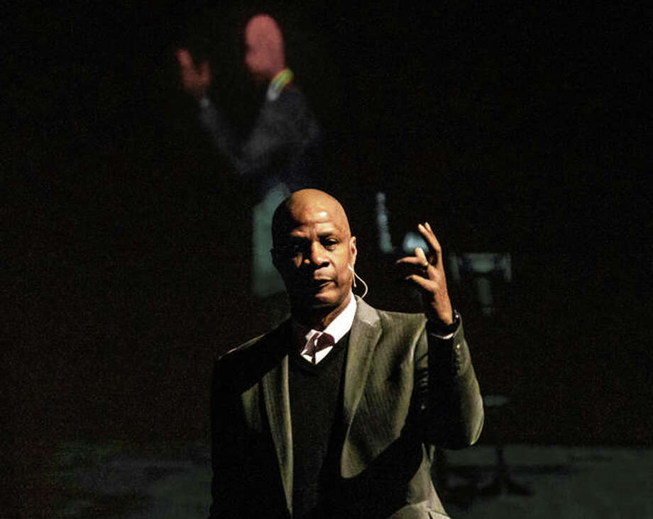 Former New York Mets and New York Yankees star and now St. Charles, Missouri-based evangelist Darryl Strawberry talks about finding religion and redemption Friday morning at Metro Community Church during a fundraiser luncheon for the Metro East chapter of the Greater St. Louis Fellowship of Christian Athletes (FCA). The former baseball great, turned ordained minister appears on a projection screen in the background. Photo: Nathan Woodside | The Telegraph
