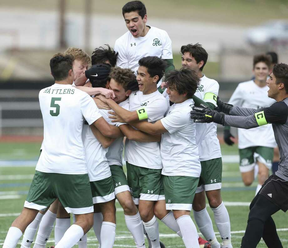 The Rattlers celebrate a goal by Isaiah McAlanis in the first period as Johnson plays Reagan in boys soccer at Comalander Stadium on January 29, 2019. Photo: Tom Reel /Staff Photographer / 2019 SAN ANTONIO EXPRESS-NEWS