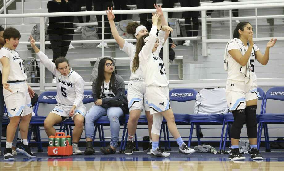The Harlan bench cheers a three pointer as Harlan hosts Southwest Legacy in girls basketball at Harlan High School on February 1, 2019. Photo: Tom Reel, Staff / Staff Photographer / 2019 SAN ANTONIO EXPRESS-NEWS