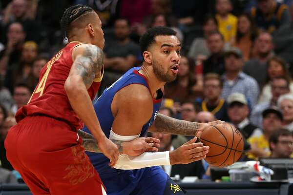 DENVER, COLORADO - FEBRUARY 01: Trey Lyles #7 of the Denver Nuggets drives against Gerald Green #14 of the Houston Rockets in the fourth quarter at the Pepsi Center on February 01, 2019 in Denver, Colorado. NOTE TO USER: User expressly acknowledges and agrees that, by downloading and or using this photograph, User is consenting to the terms and conditions of the Getty Images License Agreement. (Photo by Matthew Stockman/Getty Images)