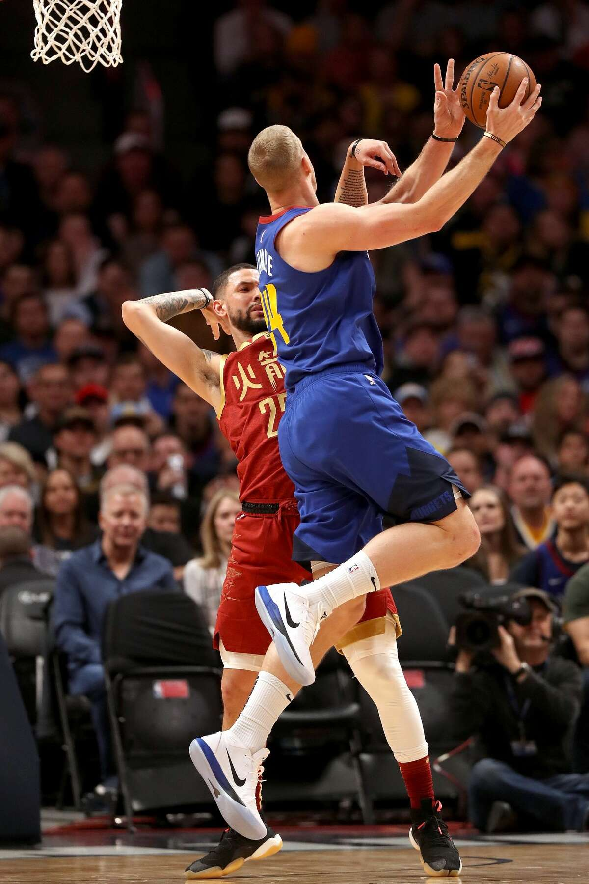 DENVER, COLORADO - FEBRUARY 01: Mason Plumlee #24 of the Denver Nuggets puts up a shot against Austin Rivers #25 of the Houston Rockets in the first quarter at the Pepsi Center on February 01, 2019 in Denver, Colorado. NOTE TO USER: User expressly acknowledges and agrees that, by downloading and or using this photograph, User is consenting to the terms and conditions of the Getty Images License Agreement. (Photo by Matthew Stockman/Getty Images)