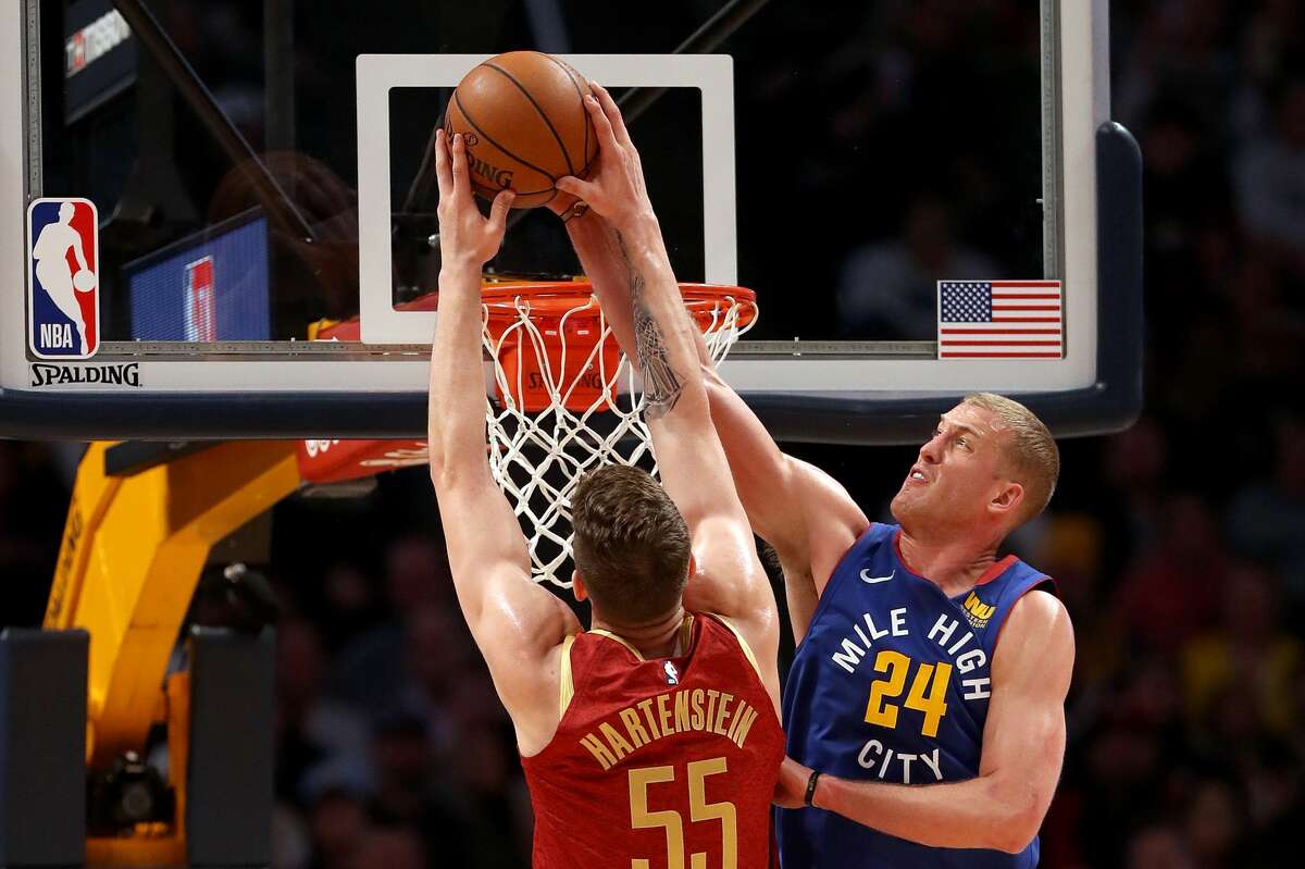 DENVER, COLORADO - FEBRUARY 01: Mason Plumlee #24 of the Denver Nuggets rejects Isaiah Hartenstein #55 of the Houston Rockets in the fourth quarter at the Pepsi Center on February 01, 2019 in Denver, Colorado. NOTE TO USER: User expressly acknowledges and agrees that, by downloading and or using this photograph, User is consenting to the terms and conditions of the Getty Images License Agreement. (Photo by Matthew Stockman/Getty Images)
