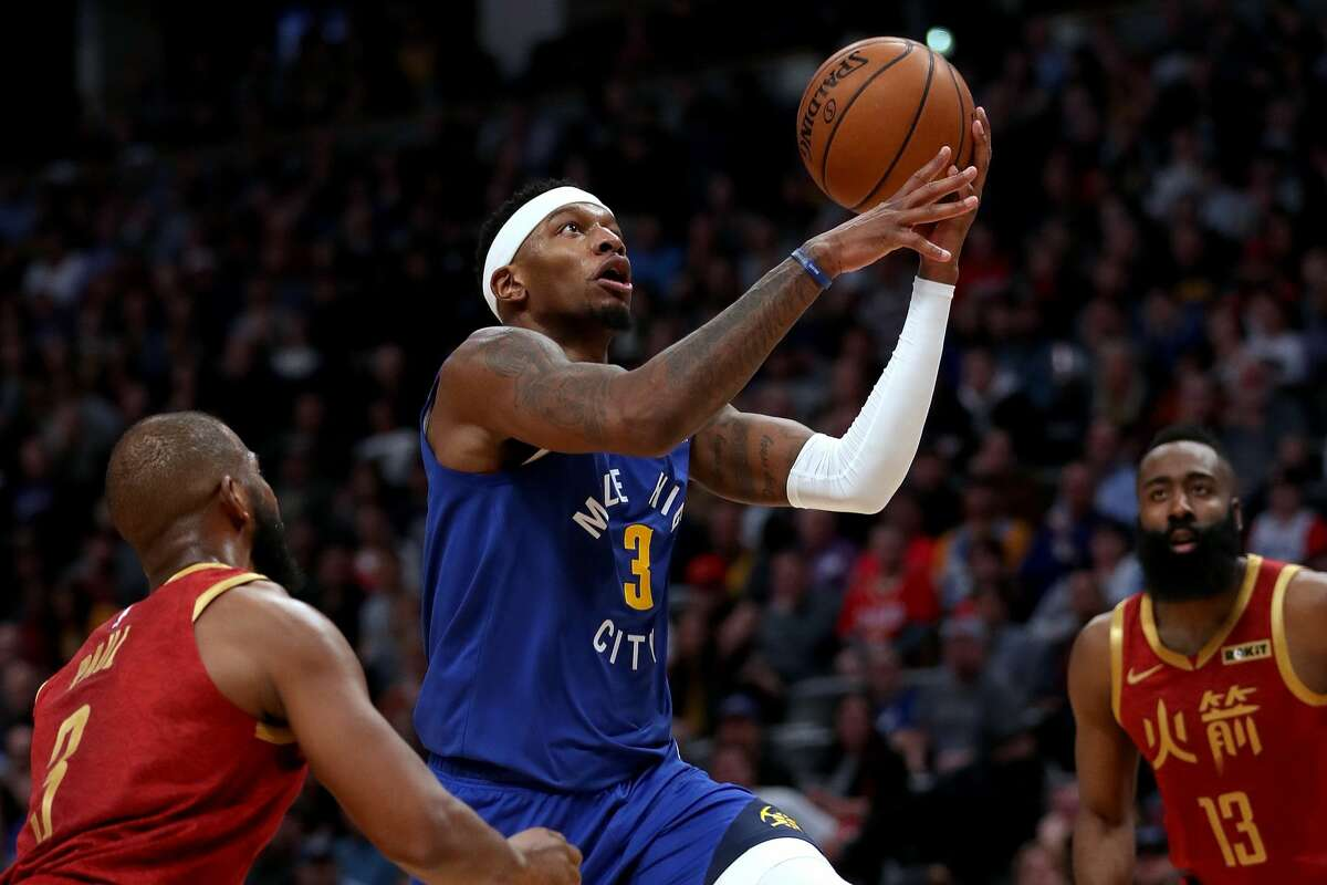 DENVER, COLORADO - FEBRUARY 01: Torrey Craig #3 of the Denver Nuggets drives to the basket against Chris Paul #3 of the Houston Rockets in the fourth quarter at the Pepsi Center on February 01, 2019 in Denver, Colorado. NOTE TO USER: User expressly acknowledges and agrees that, by downloading and or using this photograph, User is consenting to the terms and conditions of the Getty Images License Agreement. (Photo by Matthew Stockman/Getty Images)