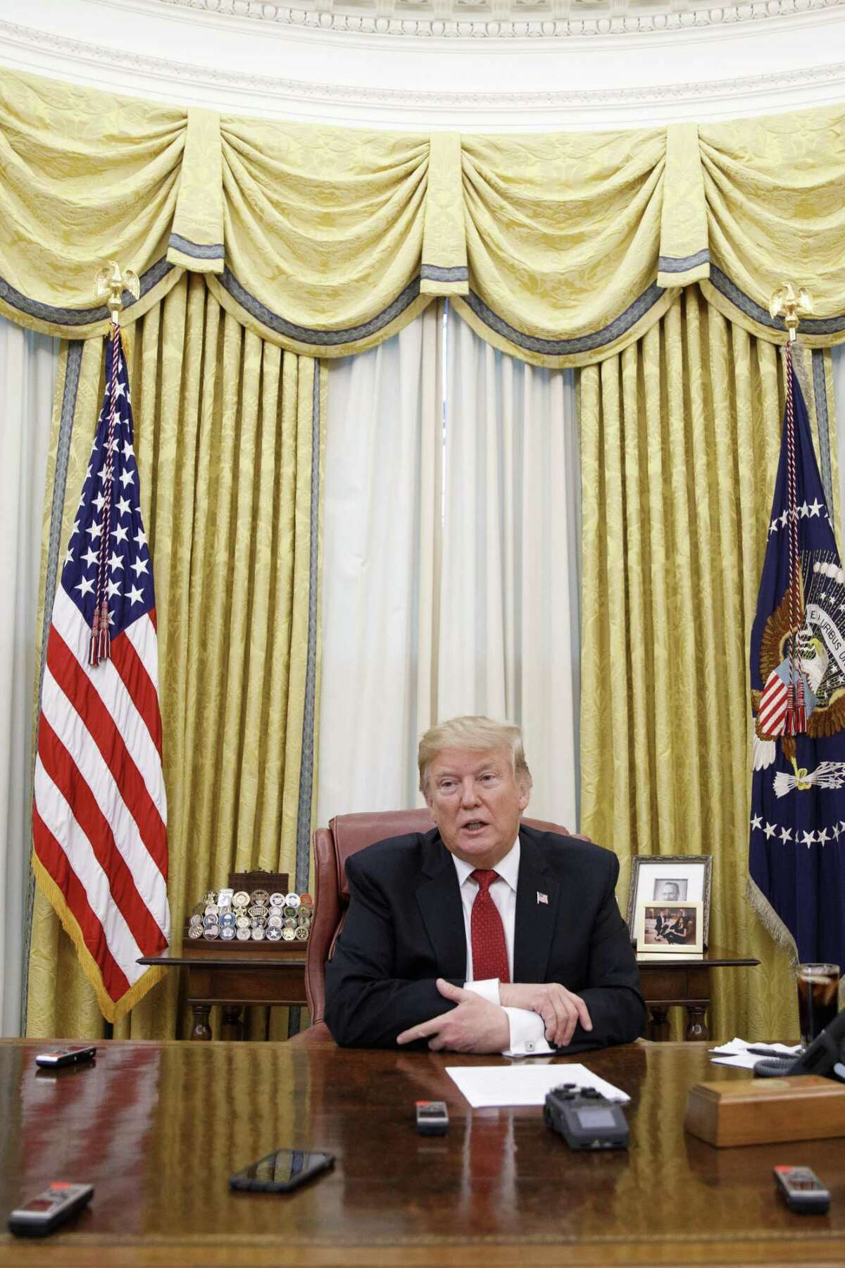 President Donald Trump speaks to reporters from The New York Times in the Oval Office, at the White House in Washington, Jan. 31, 2019. A defiant Trump declared here that he has all but given up on negotiations with Congress over his border wall and will proceed without lawmakers, but would not directly say that he plans to declare a national emergency.