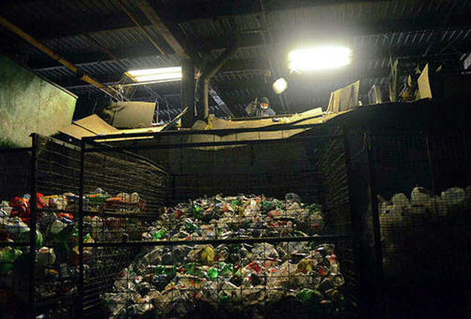 An employee of Southern Recycling sorts plastic recyclables inside the company's Carbondale facility. Owner Tasis Karayiannis has begun to refuse mixed plastics. Karayiannis doesn't want them because there's nowhere he can ship them. Photo: Gabe Neely-Streit | The Southern Illinoisan (AP)