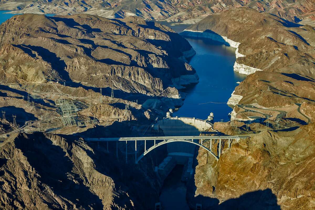 A 2015 file image shows a low water level in Lake Mead reservoir and Hoover Dam with a