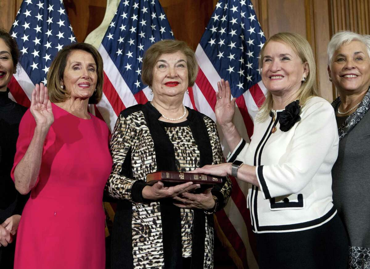 House Speaker Nancy Pelosi of Calif., administers the House oath of office to Rep. Sylvia Garcia, D-Houston, during ceremonial swearing-in on Capitol Hill in Washington, Thursday, Jan. 3, 2019, during the opening session of the 116th Congress. (AP Photo/Jose Luis Magana)