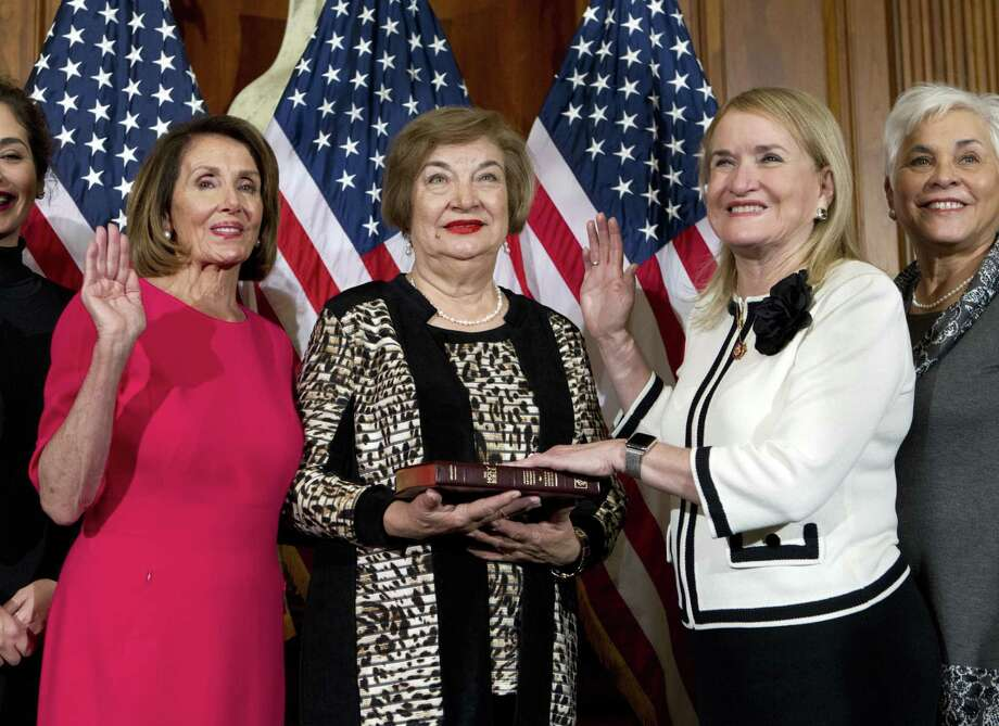 House Speaker Nancy Pelosi of Calif., administers the House oath of office to Rep. Sylvia Garcia, D-Houston, during ceremonial swearing-in on Capitol Hill in Washington, Thursday, Jan. 3, 2019, during the opening session of the 116th Congress. (AP Photo/Jose Luis Magana) Photo: Jose Luis Magana, FRE / Associated Press / Copyright 2018 The Associated Press. All rights reserved