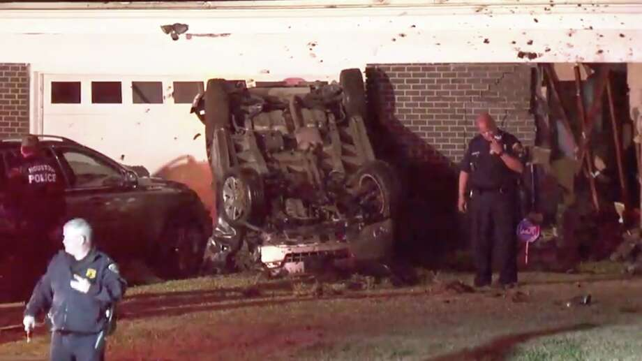 A man died early Saturday morning after he lost control of his SUV, flipped over and crashed into the front of a home, police said. Photo: Metro Video