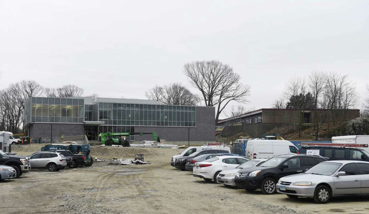 Construction continues on the new New Lebanon School, left, beside the current building in the Byram section of Greenwich, Conn. Wednesday, Jan. 23, 2019. Students are expected to move into the new facility and begin class on Tuesday, Feb. 19, following winter break.