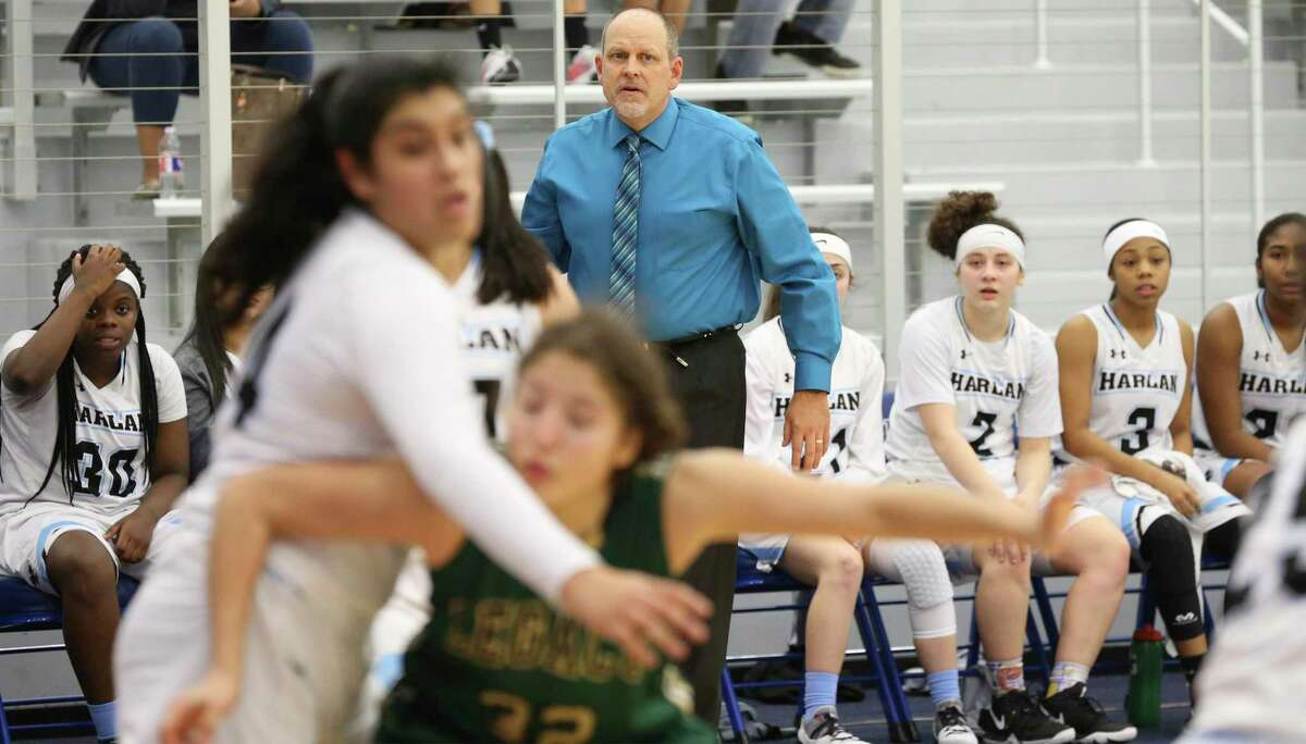 Coach Terry Barton watches his team's defense as Harlan hosts Southwest Legacy in girls basketball at Harlan High School on February 1, 2019.