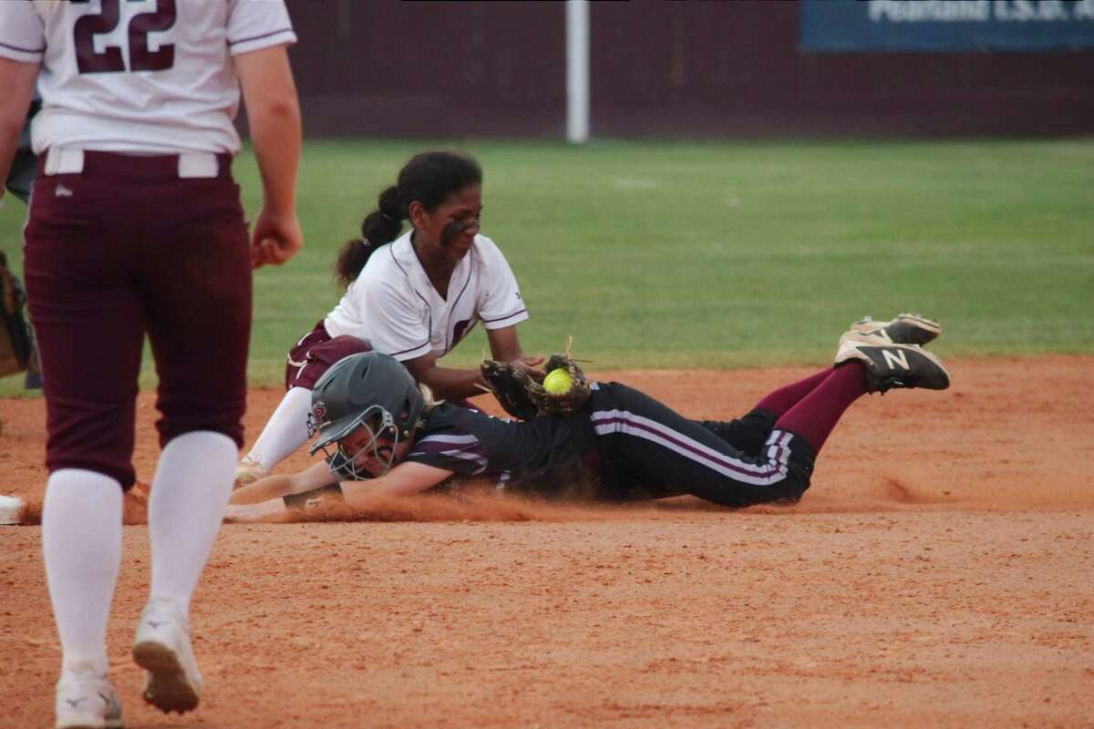 Clear Creek's Pam Richardson, making the tag against Pearland, moves to centerfield this season to strengthen the Lady Wildcat defense.