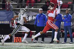 Mater Dei's Bru McCoy, catching a touchdown pass in the CIF state title game, has transferred to Texas from Southern Cal.