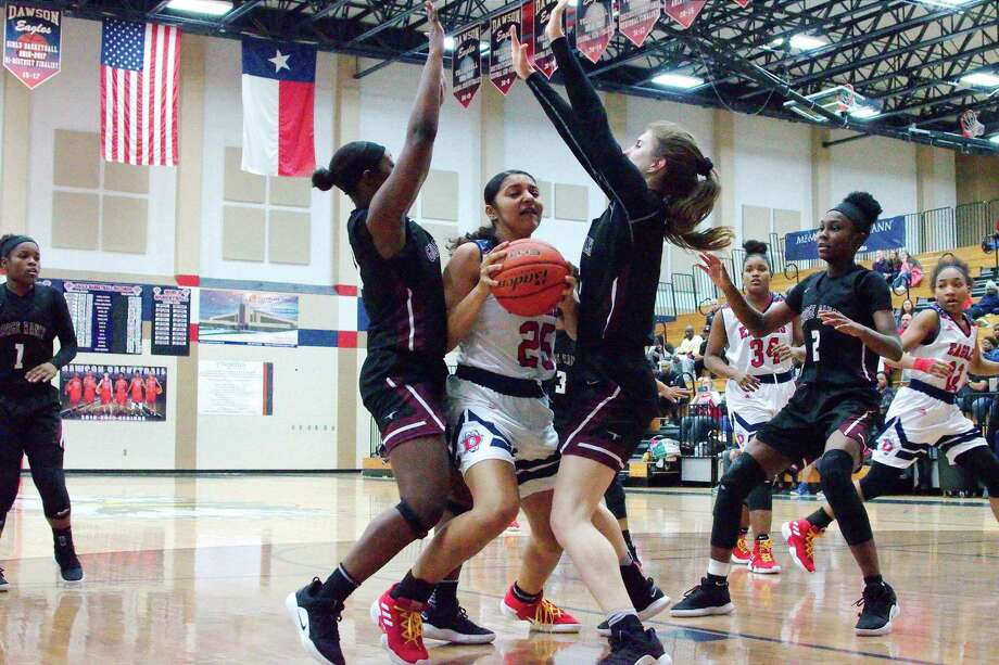 Dawson's Kyra Lunford (25) is guarded closely by George Ranch's Milan Francis-Miller (00) and Isabella Little (11) Friday at Dawson High School. Photo: Kirk Sides / Staff Photographer / © 2018 Kirk Sides / Houston Chronicle