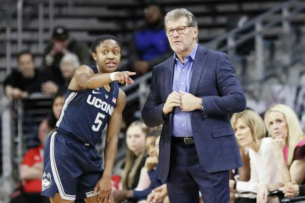 Connecticut coach Geno Auriemma, right, would like to see Crystal Dangerfield be more of a risk-taker on the court.