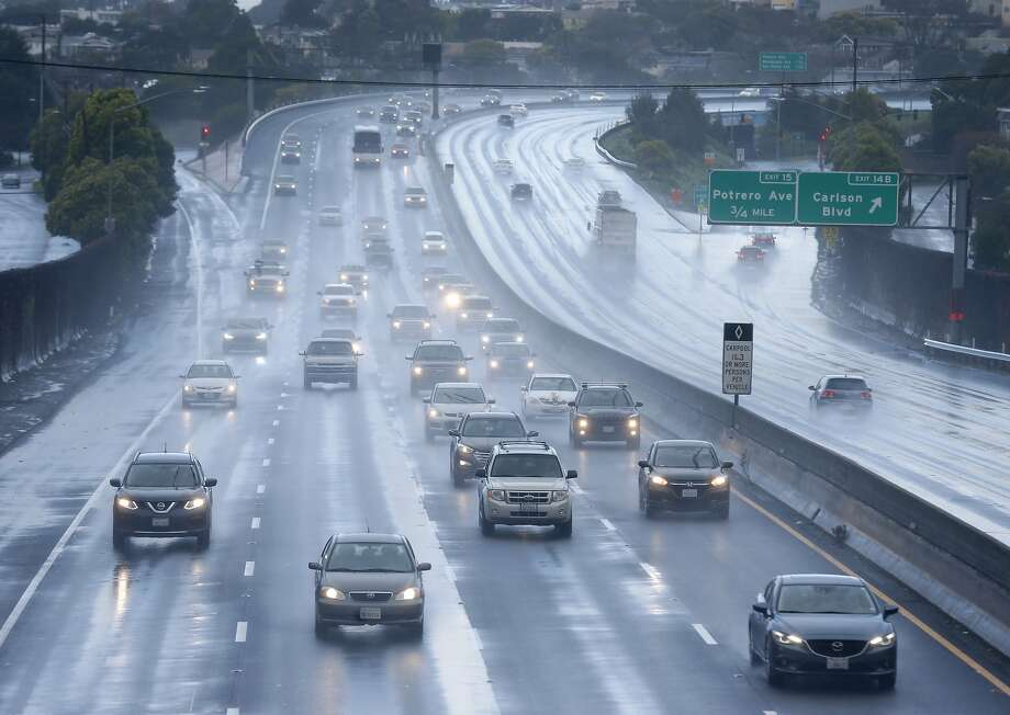 Motorists travel on wet pavement on westbound Interstate 80 during the morning rainstorm in El Cerrito, Calif. on Saturday, Feb. 2, 2019. Photo: Paul Chinn / The Chronicle
