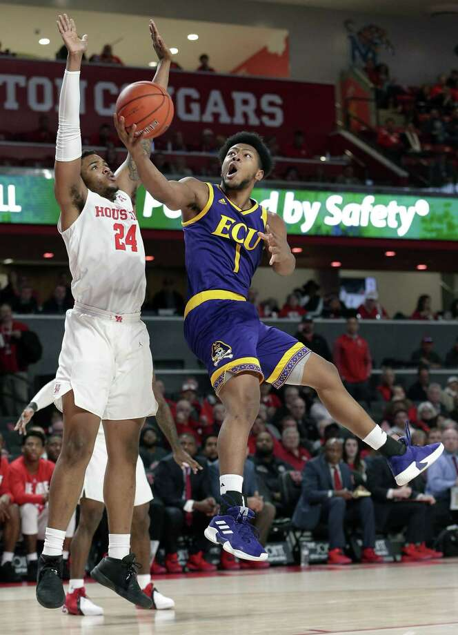 Jayden Gardner, right, and East Carolina take on UConn on Sunday in Hartford. Photo: Michael Wyke / Associated Press / Copyright 2019 The Associated Press. All rights reserved.