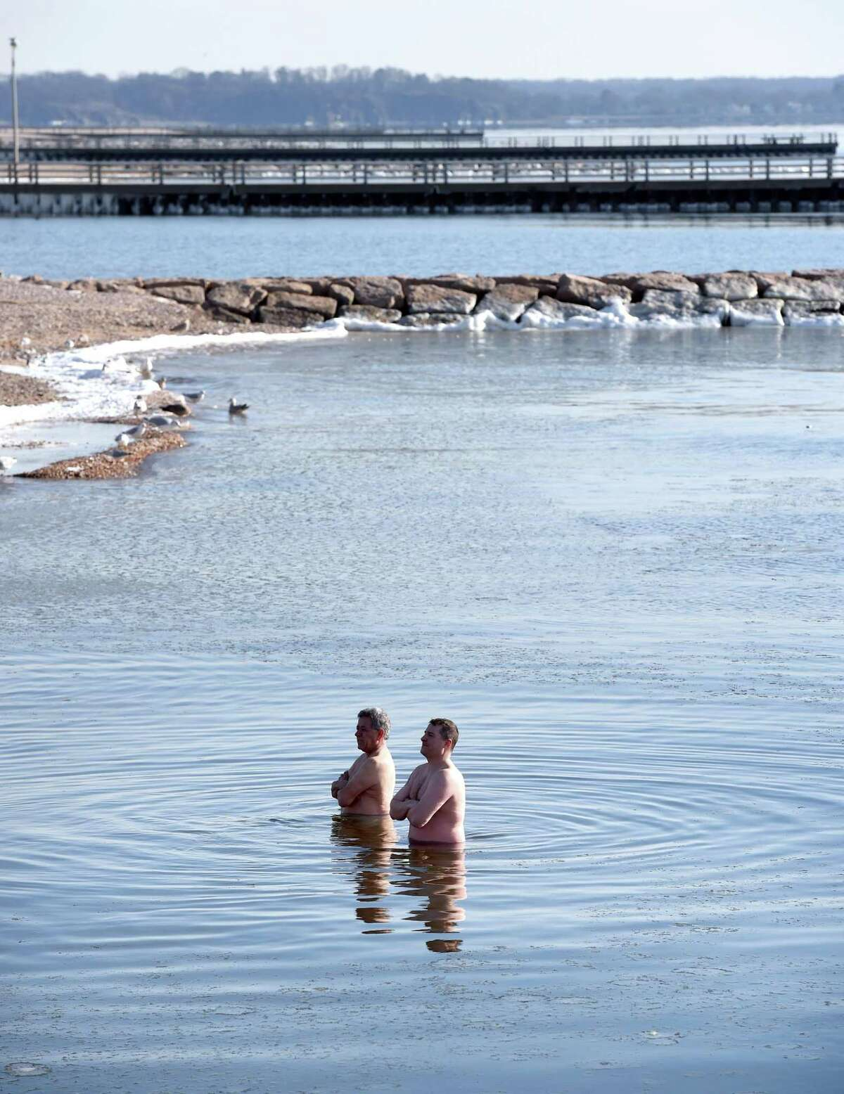 Anthony Cordone (left) of West Haven and Chris Molyneux of Seymour remain in the Long Island Sound at Savin Rock in West Haven as the last two participants in the Icy Plunge for the Cure to raise funds for the West Haven Breast Cancer Awareness Program on Feb. 2, 2019.