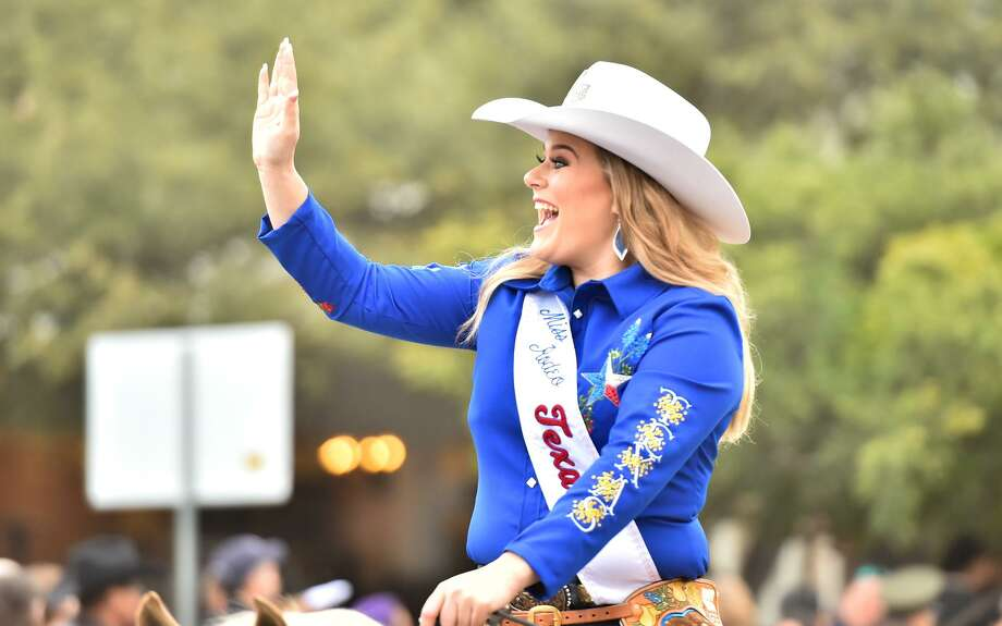 Miss Texas Rodeo Lisa Lageschaar waves to the crowd during the 12th Annual Western Heritage Parade and Cattle Drive through downtown San Antonio Saturday. Photo: Robin Jerstad/Contributor, Photo Correspondent / San Antonio Express News / ROBERT JERSTAD