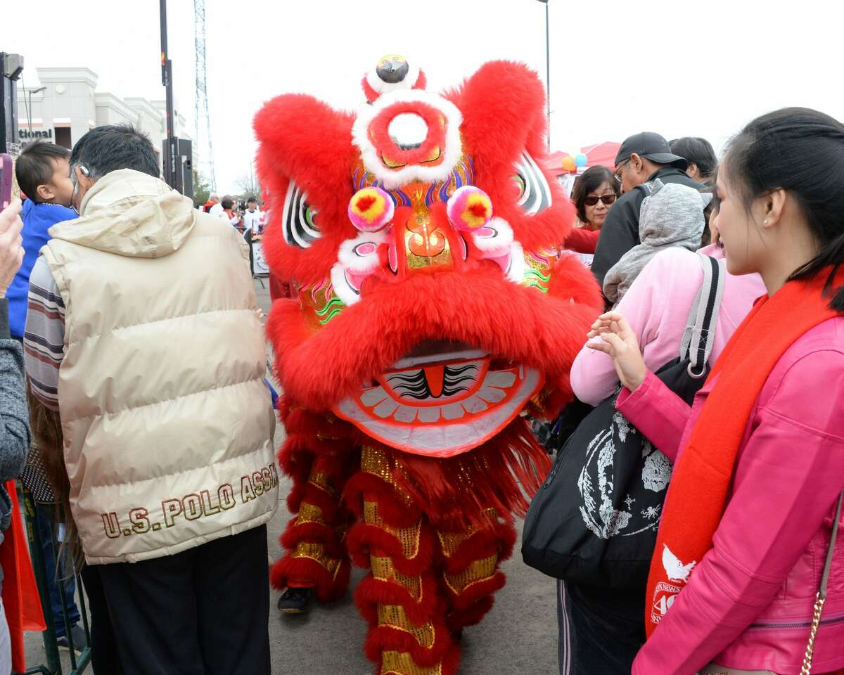 Lion dancers from the Shaolin Temple Cultural Center perfom among the attendees at the Texas International Lunar Festival in Houston, on Saturday, February 2, 2019.