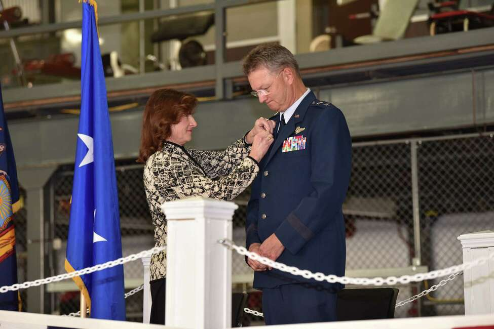 Diana German pins a retirement pin on her husband Maj. Gen. Anthony German during his retirement ceremony at Stratton Air Guard Base on Feb.2. (State Division of Military and Naval Affairs)