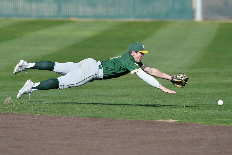 Midland College's Will Harrison dives for a ball hit by McLennan Community College Feb. 2, 2019, at Christensen Stadium. James Durbin / Reporter-Telegram Photo: James Durbin / Midland Reporter-Telegram / ? 2019 All Rights Reserved