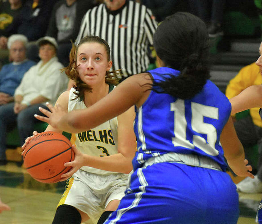 MELHS guard Sami Kasting eyes the basket as she prepares to make a running jumper in the lane to go over 1,000 points for her career.
