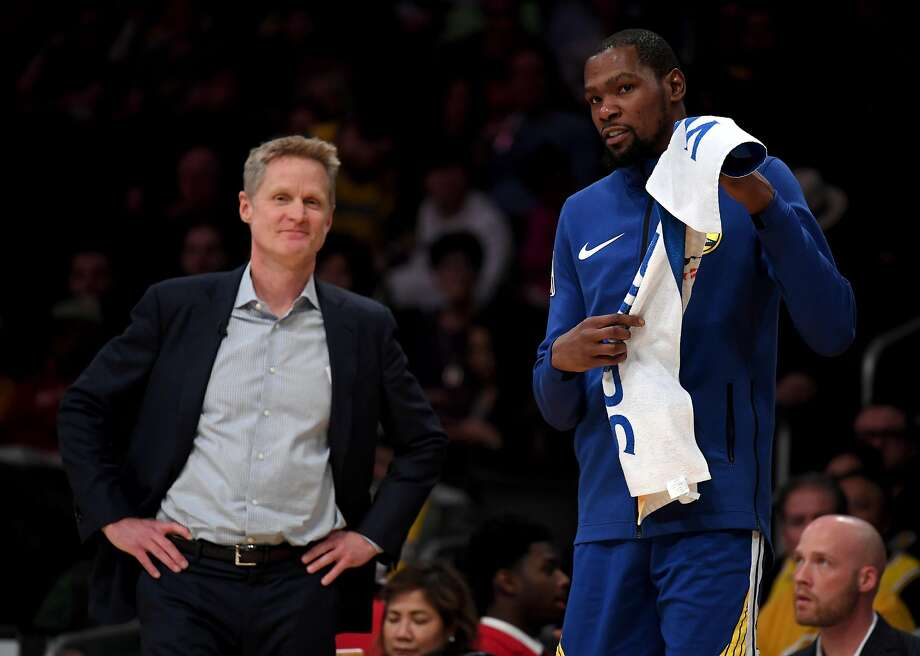 LOS ANGELES, CALIFORNIA - JANUARY 21: Kevin Durant #35 and Steve Kerr of the Golden State Warriors smile courtside during a 130-111 win over the Los Angeles Lakers at Staples Center on January 21, 2019 in Los Angeles, California. NOTE TO USER: User expressly acknowledges and agrees that, by downloading and or using this photograph, User is consenting to the terms and conditions of the Getty Images License Agreement. (Photo by Harry How/Getty Images) Photo: Harry How / Getty Images