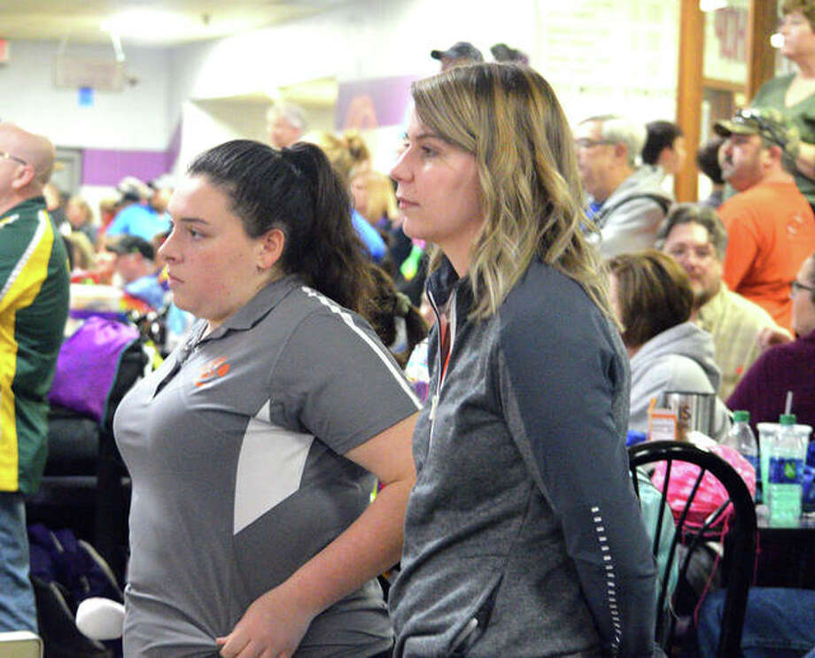 Edwardsville senior bowler Sydney Sahuri, left, and EHS coach Kimber Moscardelli watch the action on Saturday afternoon during the Collinsville Regional at Camelot Bowl. Photo: Scott Marion/Intelligencer