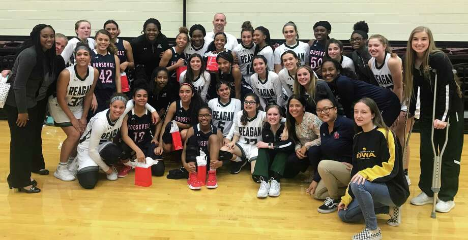 Reagan senior Celeste Curiel (bottom row in white uniform and glasses) poses with her teammates and members of Roosevelt's girls basketball team following their game on Friday, Feb. 1, 2019 at Littleton Gym Photo: Submitted