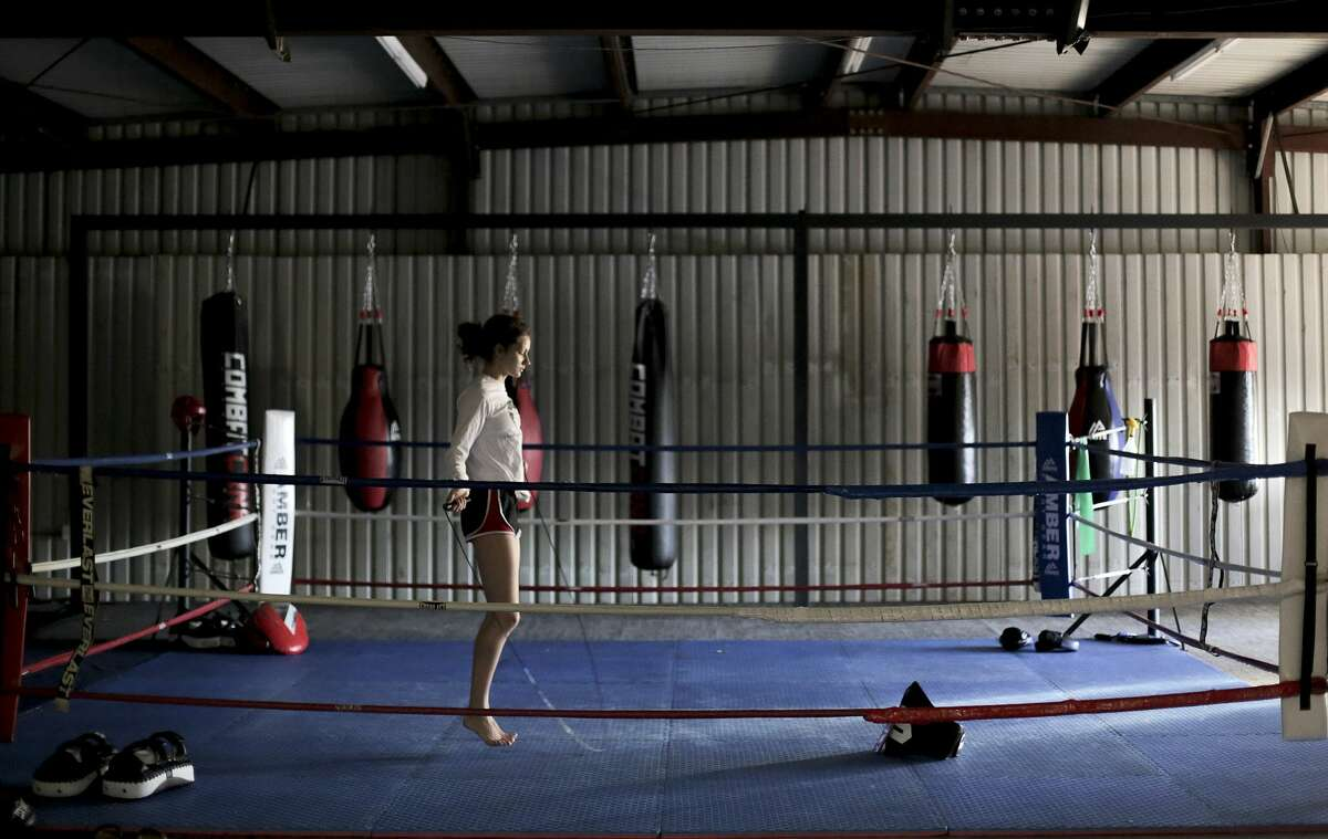 Bekah jumps rope to warm up before her workout at Heritage Muay Thai in Houston on Thursday, Jan. 24, 2019.