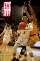 Stanford guard DiJonai Carrington (21) drives to the basket against California center Kristine Anigwe (31) during the second quarter of an NCAA women's basketball game on Saturday, Feb. 2, 2019 in Stanford, Calif.