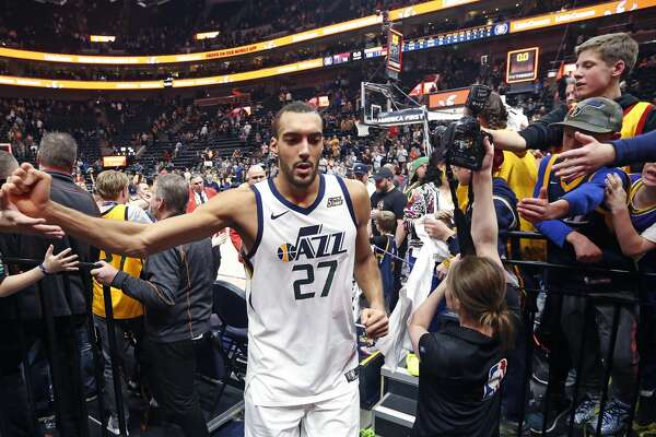 0ed7fe035 1of83PHOTOS  Rockets game-by-game Fans reach for Utah Jazz center Rudy  Gobert as he leaves the court following the team s NBA basketball game  against the ...