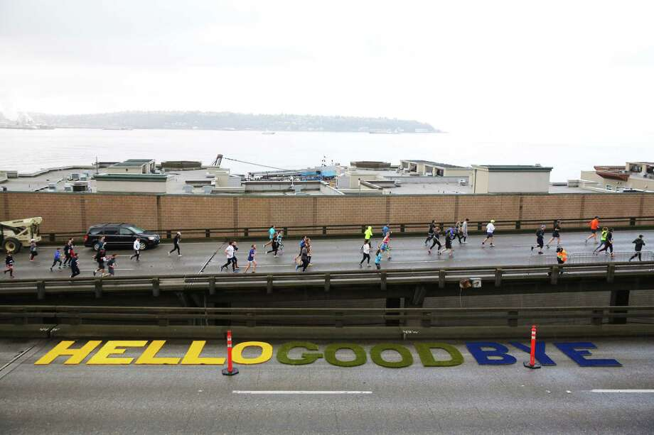 Twenty-nine thousand people participate in the Tunnel to Viaduct 8k, which allowed runners and walkers to travel south through the new S-R 99 tunnel and north over the lower deck of the Alaskan Way Viaduct, Saturday, Feb. 2, 2019. Many runners stopped to take photos along the route, capturing what would be their last chance to walk along the viaduct before it is demolished later this month. The 8K is part of a weekend-long celebration marking the opening of the new tunnel, which 100,000 people were expected to attend. (Genna Martin, SeattlePI) Photo: GENNA MARTIN, Seattlepi.com / SeattlePI