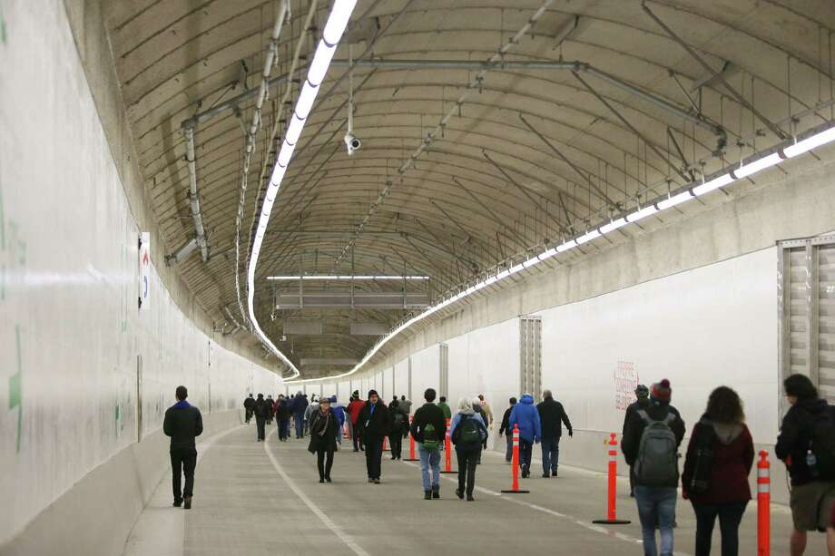 People walk through the new SR 99 tunnel after an official ribbon cutting ceremony to celebrate its opening, Saturday, Jan. 2, 2019. As many as 100,000 people are expected to attend the weekend-long celebration to say goodbye to the Alaskan Way Viaduct and hello to the new tunnel. (Genna Martin, SeattlePI) Photo: GENNA MARTIN, Seattlepi.com / SeattlePI