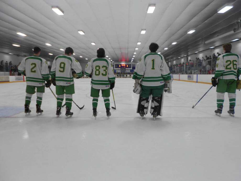 Notre Dame-West Haven (in white) and Hamden line up for introductions before their SCC/SWC Division I hockey game Saturday night at Bennett Rink. Hamden won 5-2. Photo: Michael Fornabaio