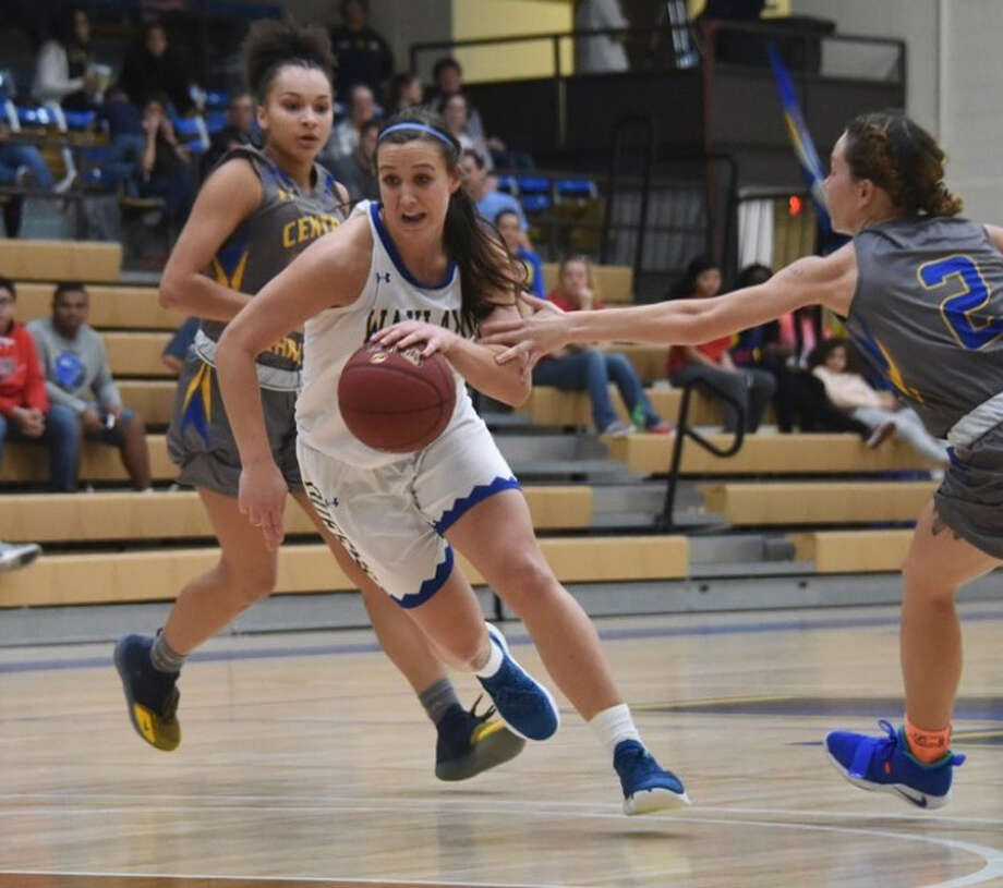 Wayland Baptist freshman Cailyn Breckel gets past Central Christian senior Piper Kalthoff (2) and drives to the basket during Saturday's Sooner Athletic Conference at Hutcherson Center. Photo: Claudia Lusk/Wayland Baptist University