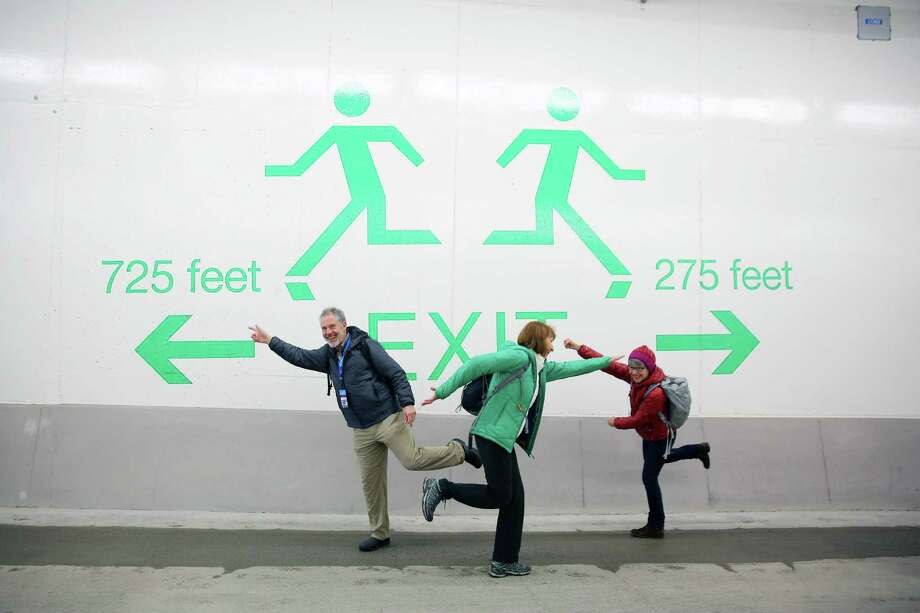 People walk through the new SR 99 tunnel after an offical ribbon cutting ceremony to celebrate its opening, Saturday, Jan. 2, 2019. As many as 100,000 people are expected to attend the weekend-long celebration to say goodbye to the Alaskan Way Viaduct and hello to the new tunnel. (Genna Martin, SeattlePI) Photo: GENNA MARTIN, Seattlepi.com / SeattlePI