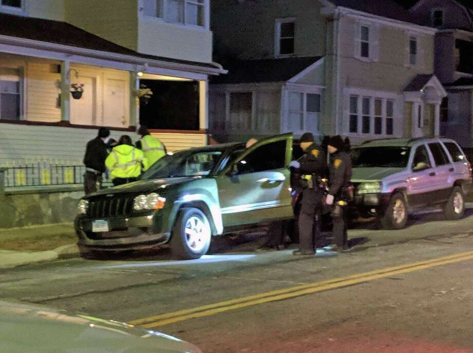 Bridgeport, Conn., police investigate a vehicle that was reportedly shot at in the area of Orchard and Spring streets.. An occupant in the vehicle told police she was grazed by a bullet and was just bruised by it on Feb. 2, 2019. This was the fourth of five reports of shots fired between 4 p.m. and 10:30 p.m. Saturday. Photo: Contributed Photo / Connecticut Post Contributed